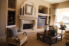 Luxury Living Room. A beautiful living room with ornate fireplace and elegant decor Royalty Free Stock Photos