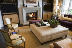 Luxury living room. Luxury home living room with a fireplace Royalty Free Stock Image