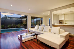 Luxury Living Room. Living room in a luxury home also showing rear courtyard and kitchen Stock Images