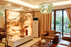 Luxury living room. With dark brown leather sofa,marble TV setting wall,led glass droplight Royalty Free Stock Photos