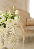 Luxury living room decorated by white flowers Royalty Free Stock Photos