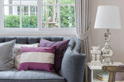 Luxury living room design with sofa and lamp on table Stock Photos
