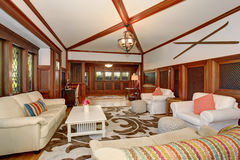 Luxury Living room interior with brown wooden trimmings and vaulted ceiling with beams Royalty Free Stock Photos