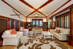 Luxury Living room interior with built-in furniture, vaulted ceiling and beams Stock Photo