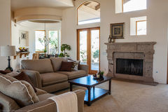 Luxury living room. Modern Luxury living room with fireplace and comfy sofas Stock Photo