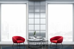 Luxury living room with red armchairs royalty free stock photography