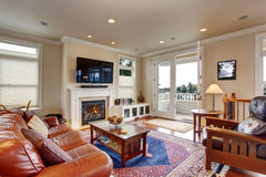 Luxury living room with red and blue rug. Royalty Free Stock Image