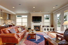Luxury living room with red and blue rug. Royalty Free Stock Photos