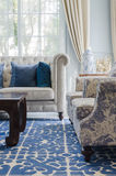 Luxury living room with sofa on blue pattern carpet Royalty Free Stock Image