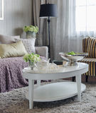 Luxury living room with sofa and white table on carpet at hom Stock Photography