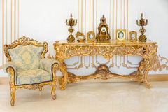 Luxury livingroom in light colors with golden furniture details. Elegant classic interior Royalty Free Stock Images