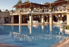Luxury Lodge overlooking pool. Magnificent luxurious lodge overlooking great pool, at 'golden hour Stock Photos