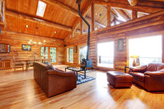Luxury log cabin living room with leather sofa. stock photo