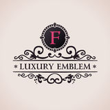 Luxury logo. Calligraphic pattern elegant decor Royalty Free Stock Images