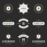 Luxury logos templates set, flourishes calligraphic elegant ornament lines. Royalty Free Stock Photos