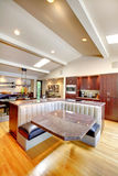 Luxury mahogany Kitchen with modern furniture. Royalty Free Stock Photos