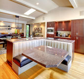 Luxury mahogany Kitchen with modern furniture. Luxury mahogany Kitchen with modern custom furniture design. Vaulted ceiling Stock Photography