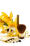 Luxury makeup set. With festive golden ribbon and Iris flower. Perfect gift for a fashion loving woman. Isolated on white royalty free stock photography