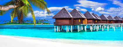 Luxury Maldives vacation - panorama with water bungalows Stock Photo