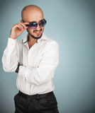 Luxury man in sunglasses and white shirt looking away Stock Photo