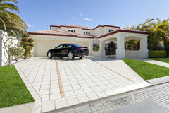 Luxury mansion. With luxury car in driveway Royalty Free Stock Photos