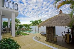 Luxury mansion outside deck with Bali hut Royalty Free Stock Photos