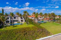 Luxury mansions Boynton Beach Boca Raton FL. Aerial image of beachfront mansions in South Florida tropical palm trees and blue skies Royalty Free Stock Photography