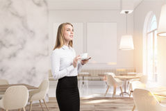 Luxury marble cafe, two posters, woman Stock Image