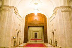 Luxury marble hallway. A view of down a high marble hallway in a luxurious building royalty free stock image