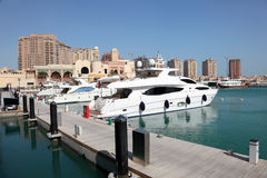 Luxury marina in Doha, Qatar. Luxury marina in Porto Arabia. Doha, Qatar, Middle East Royalty Free Stock Images