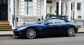 Luxury Maserati blue GranCupe in front of English townhouse. LONDON, UNITED KINGDOM - MAR 11, 2017: Luxury Maseratti GranCabrio blue exclusive cabrio car parked Stock Images