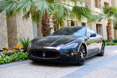 The luxury Maserati Granturismo car is near luxurious hotel Royalty Free Stock Image