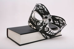 Luxury mask on black book Royalty Free Stock Photos