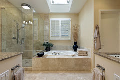 Luxury master bath with skylight. Over bath tub royalty free stock photos