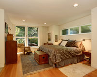 Luxury master bedroom with hardwood floor and brown bedding. Royalty Free Stock Photo