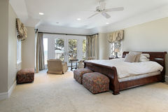 Luxury master bedroom with lake view Royalty Free Stock Images