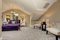 Luxury master bedroom with purple bedding. Royalty Free Stock Photos