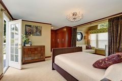 Luxury master bedroom with seperate relaxation area. Stock Photos