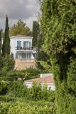 Luxury mediterranean villa with balconys. In a mediterranean landscape surrounded by trees stock photography