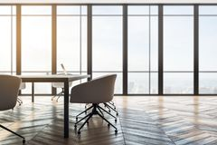 Luxury meeting room. Interior with panoramic city view, furniture, laptop on desktop and daylight. Toned image. 3D Rendering royalty free illustration