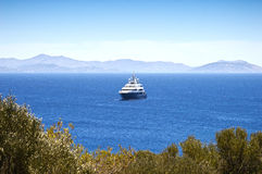 Luxury mega-yacht. View of a luxury mega-yacht in the blue sea, Greece royalty free stock image