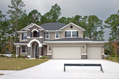 Luxury model home. Newly constructed luxury home with three car garage Royalty Free Stock Photography