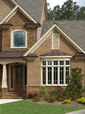 Luxury Model Home Exterior front door bay window Royalty Free Stock Photography