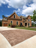 Luxury Model Home Exterior stone driveway Royalty Free Stock Photography