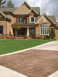 Luxury Model Home Exterior stone driveway Royalty Free Stock Image