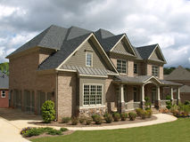 Luxury Model Home Exterior stormy weather angle Royalty Free Stock Photography