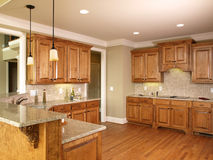 Luxury Model Home Honey Kitchen Stock Images