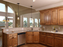 Luxury Model Home Maple Kitchen with window 2 Royalty Free Stock Photo