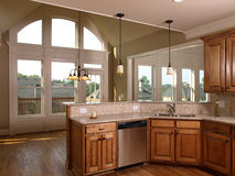 Luxury Model Home Maple Kitchen with window Royalty Free Stock Photography