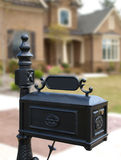 Luxury Model Home Ornate Mailbox. Luxury Model Home with Ornate Black Mailbox Stock Images